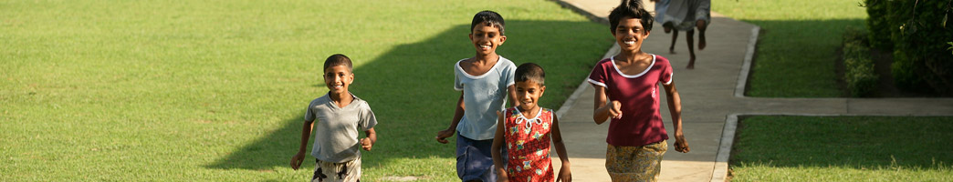 Sponsored boys and girls running in the SOS Village in Sri Lanka - Sponsor a child today