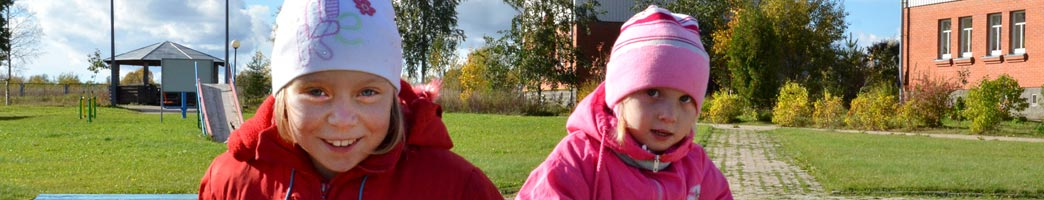 Two Russian girls in playground - Sponsor a Child in Russia
